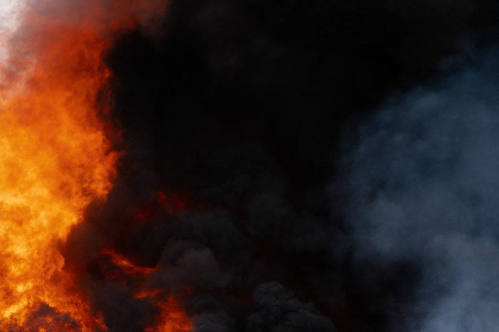 huge-flames-of-red-fire-motion-blur-clouds-of-dark-QUGT49Z