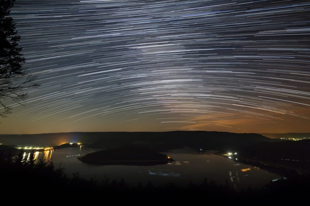 star-trails-above-lake-2021-04-02-21-00-39-utc