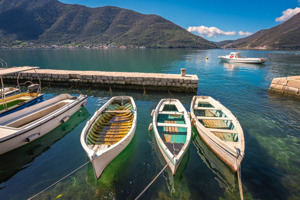 three-small-fishing-boats-in-a-kotor-bay-XR5YT3G_resize