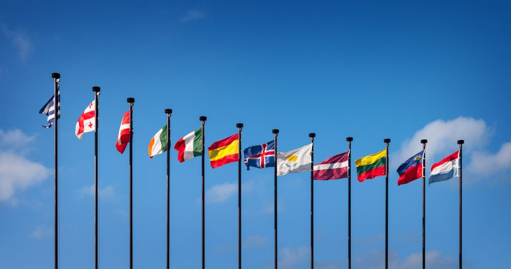 National flags of the European countries against the blue sky