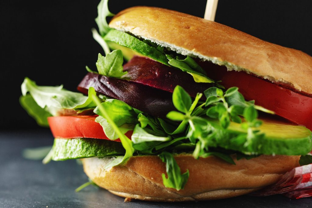 vegan-or-vegetarian-burger-on-table-L6CBRVL