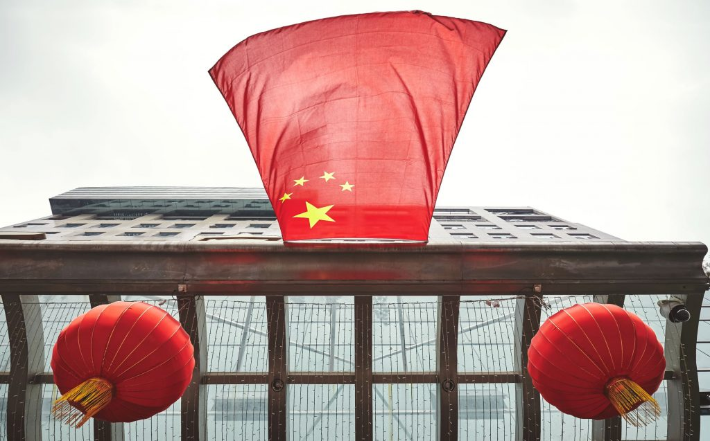 looking-up-at-chinese-flag-WHJ3YMH