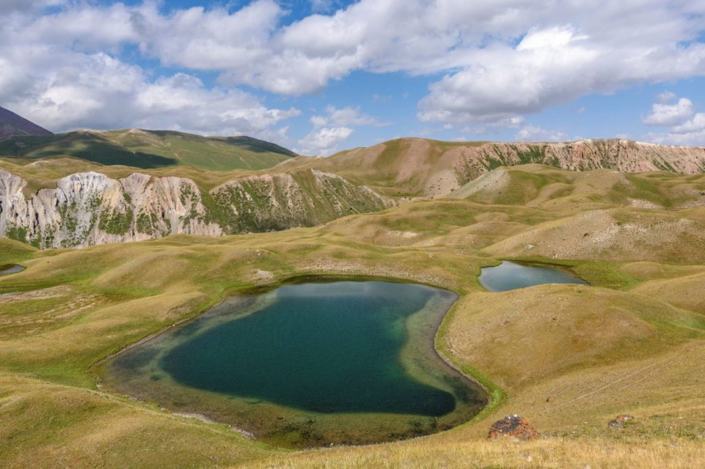landscape-view-with-lakes-in-a-valley-surrounded-b-HAGW7KU
