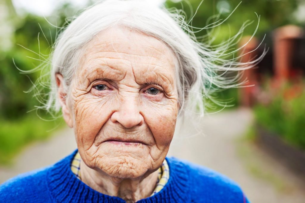 portrait-of-an-aged-woman-outdoors-PCR64LD