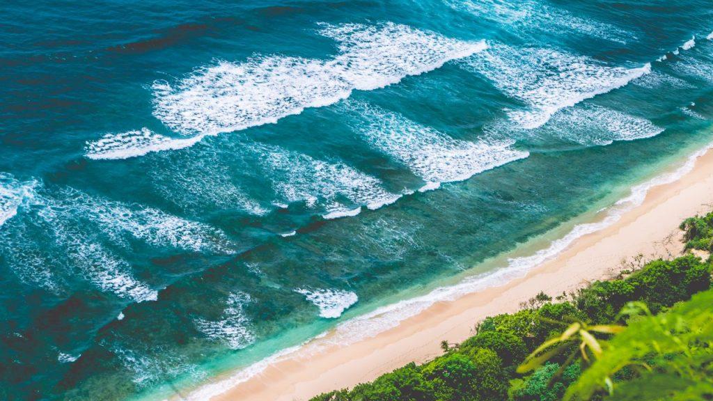 aerial-view-of-nunggalan-beach-near-uluwatu-bali-i-SDJJNHQ