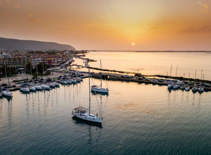 sailboats-in-the-marina-and-the-city-of-lefkada-is-TKNM47L