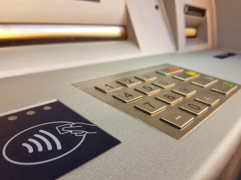 close-up-of-keypad-and-wireless-card-logo-on-atm-m-V5EW9G6
