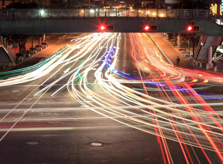 light-traces-on-crossroad-at-night-PFWBPLF