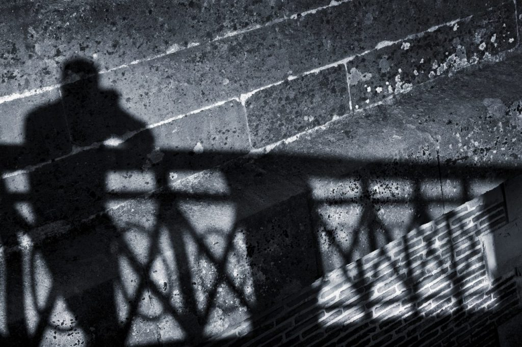 silhouette-of-a-man-on-a-wall-P73XQKQ