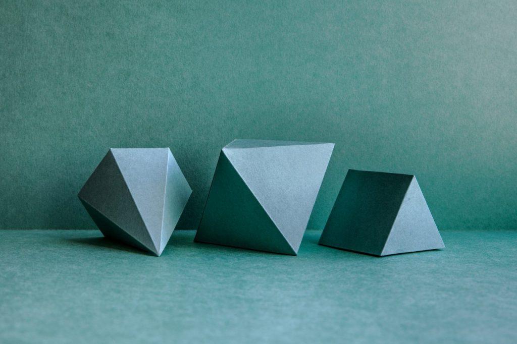 geometrical-figures-on-green-background-DXEK39U
