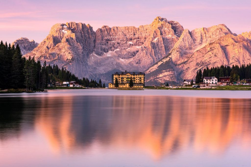 glowing-dolomites-mountains-peaks-at-sunrise-over--DZ5KCSF