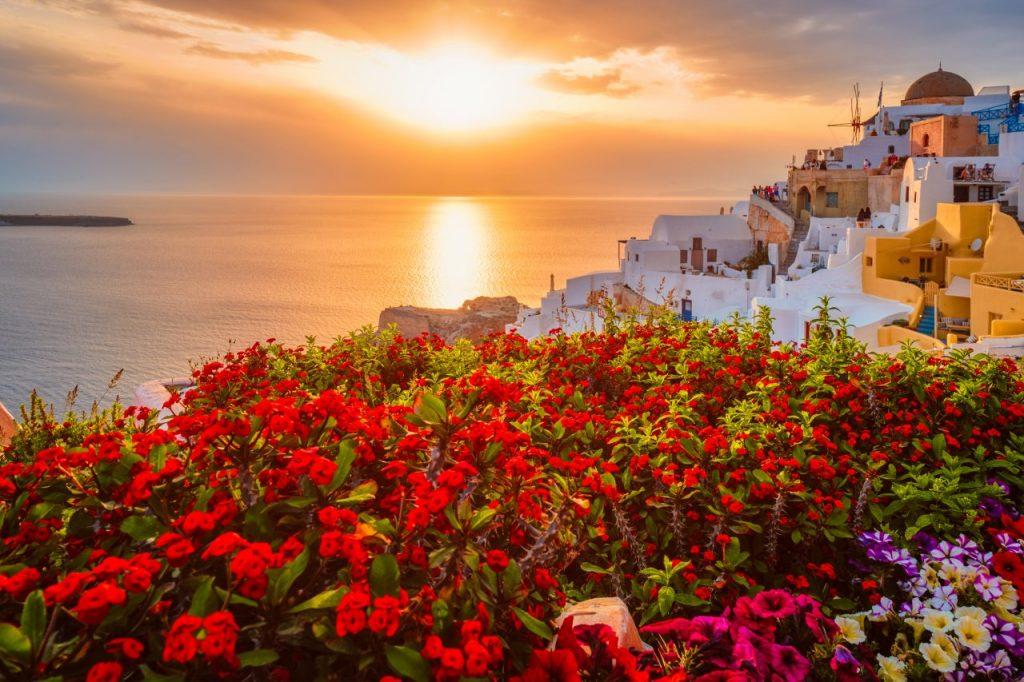 sunset-over-oia-town-on-santorini-island-in-summer-B42AS73