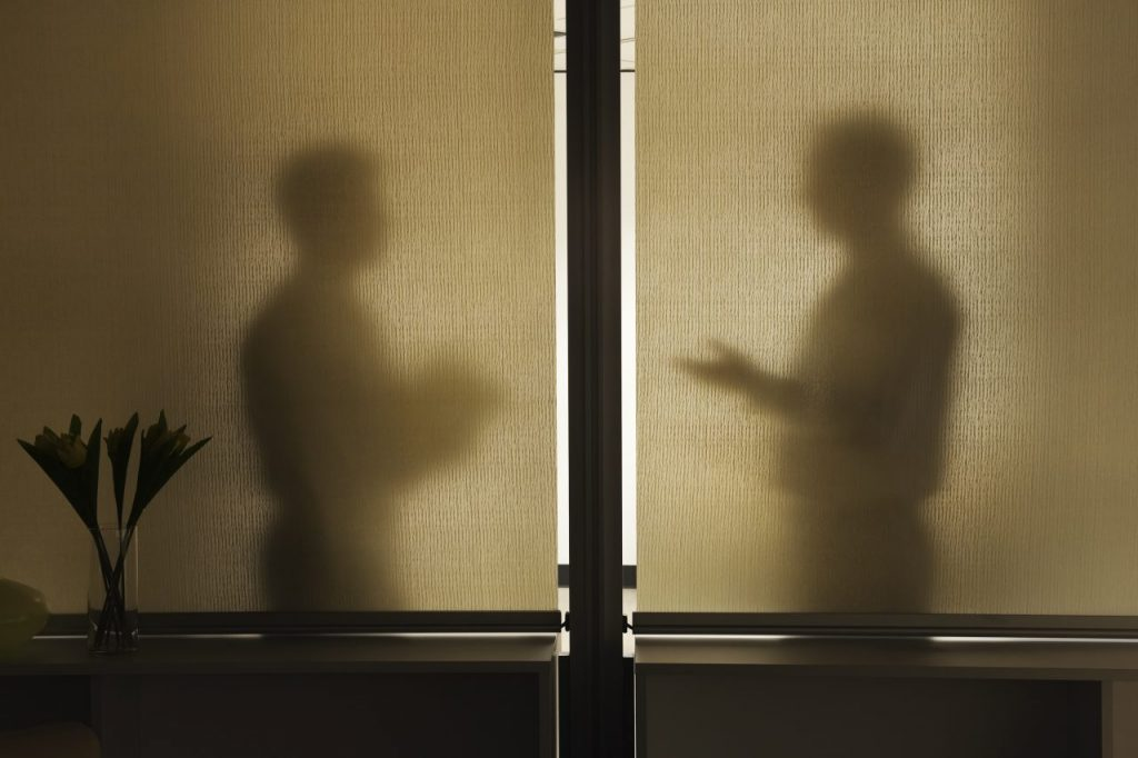 abstract-shadows-of-two-businessman-in-a-meeting-b-TNHS53T