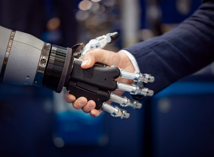 hand-of-a-businessman-shaking-hands-with-a-android-GYDH3MX