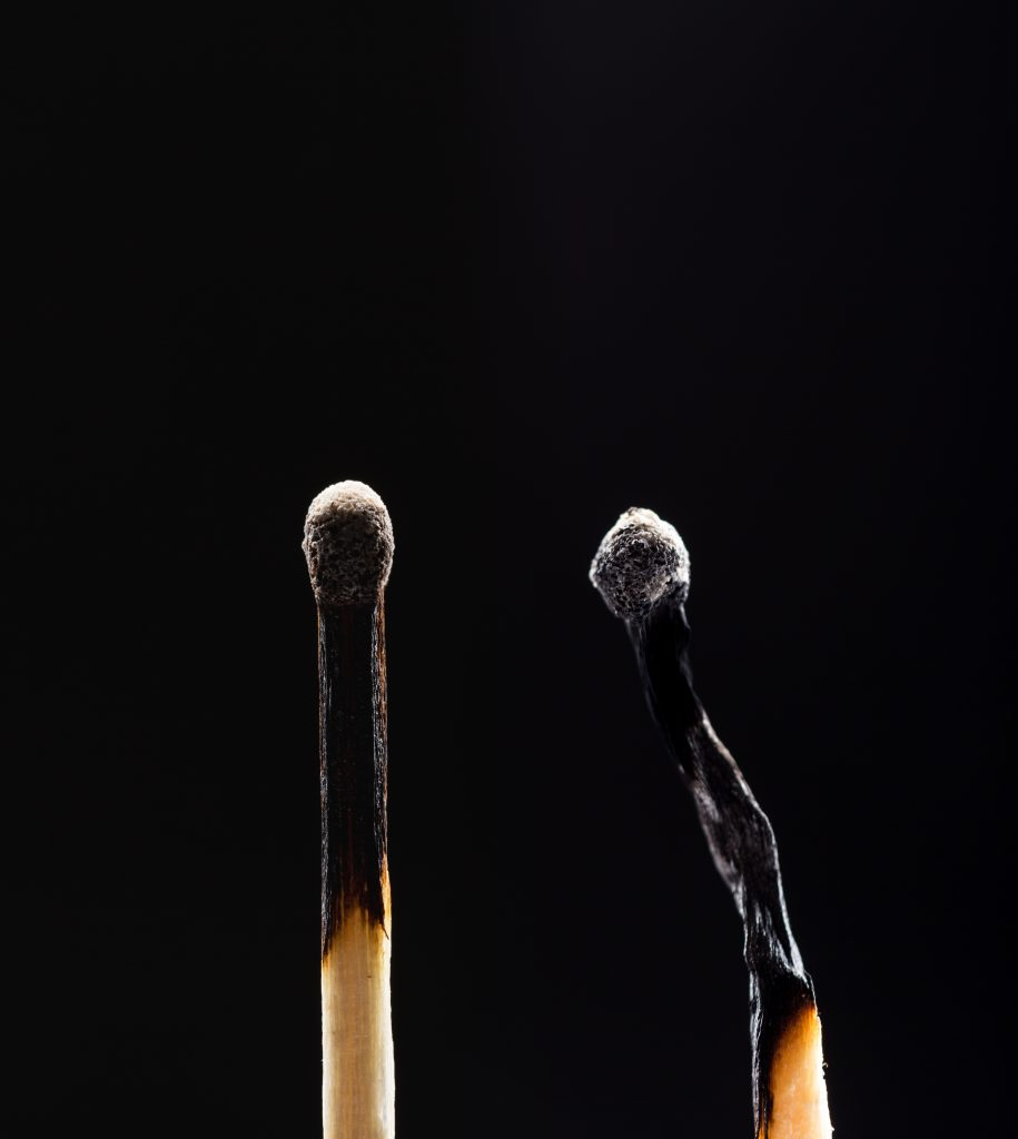 two-burned-out-wooden-matches-on-black-P5Y23QF